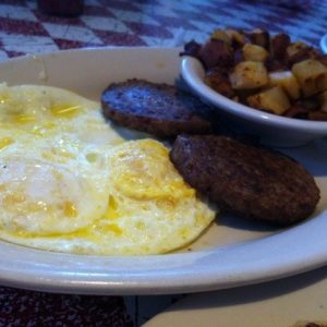 Two eggs, sausage and home fries