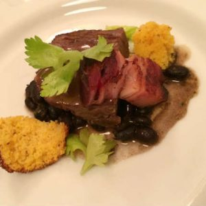 Braised Brisket, Caramelized Bacon, Cornbread, Black Beans, Blueberry BBQ sauce