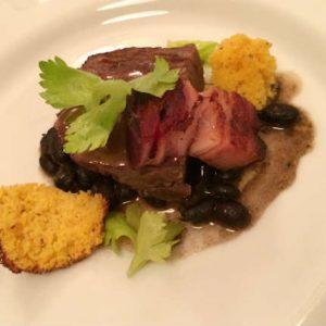 Braised Brisket, Caramelized Bacon, Cornbread, Black Beans, Blueberry BBQ sauce