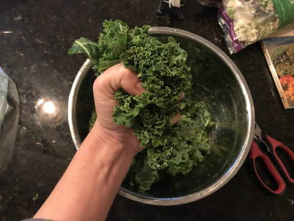 squeezing kale